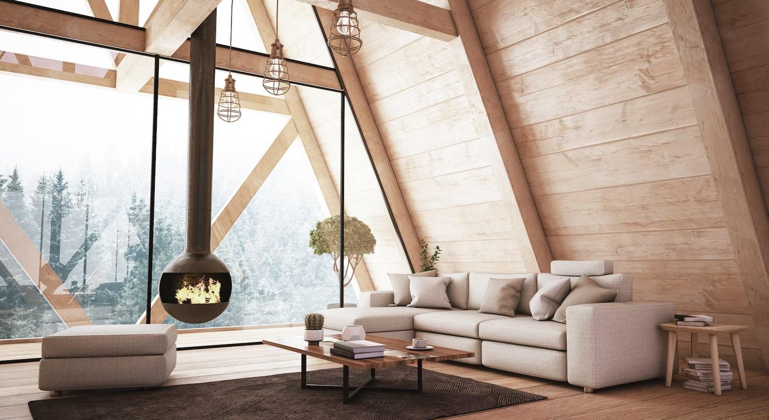 Chambre avec murs en bois. Vue sur un contrefort depuis la grande fenêtre.